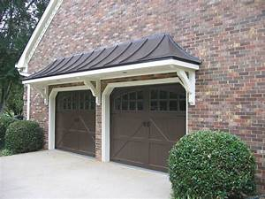 Metal roof bracket portico over double garage doors