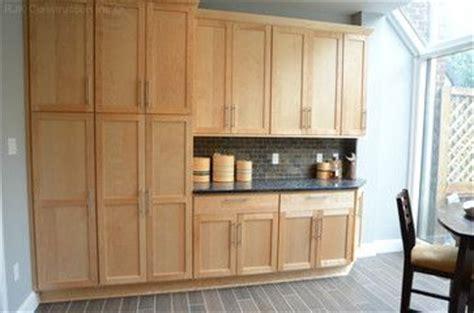 tile or wood in kitchen bertch marketplace kitchen cabinetry door style visage 8500