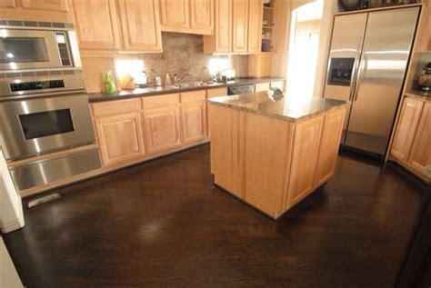 Dark floors, light cabinets kitchen   House ideas