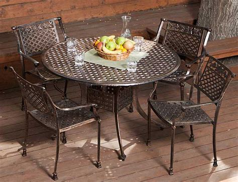 sebastian cast aluminum outdoor dining set in copper