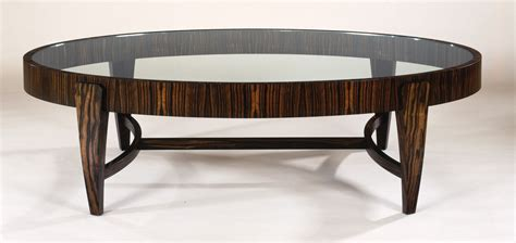 A living room with an orderly look deserves a coffee table that does it justice. Artistic Small Round Coffee Table - MidCityEast