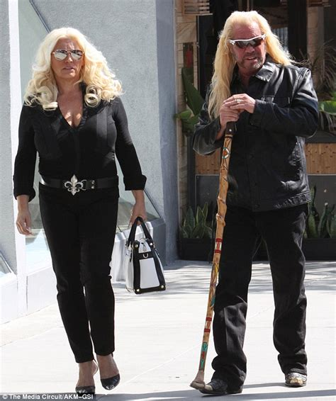 duane 39 dog 39 chapman 63 leans on walking stick as famed bounty hunter strolls with wife beth in