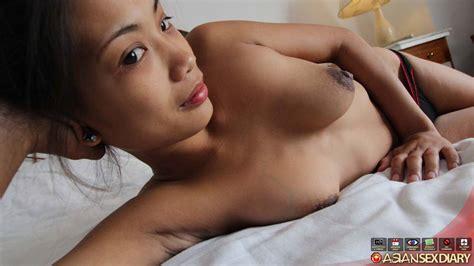 filipino milf undresses before jerking and fucking a farang