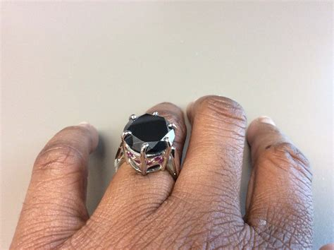large black engagement ring with ruby accents 11 65 carats