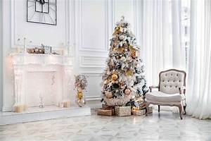 white room with white fireplace tree for