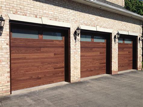 Modern Woodgrain Garage Doors With 2 Frosted Windows