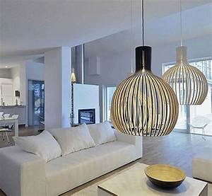 Cage shaped modern pendant lighting fixtures over a white