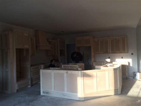 Pendant Lighting over a large angled kitchen island