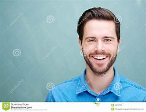 Portrait Of A Handsome Young Man With Beard Smiling ...