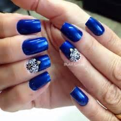 Amazing metallic dark blue nail art design this electrifying