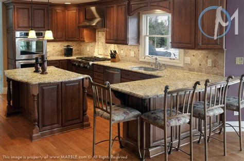 kitchen backsplash ideas with santa cecilia granite santa cecilia featured throughout this kitchen provides a warm and inviting environment ogee
