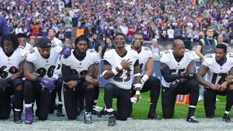 nfl players coaches owners kneel lock arms