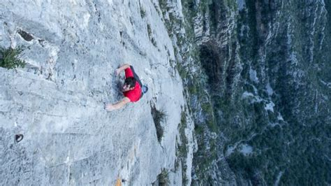Fearless Solo Climber Scales Daunting Peaks Without