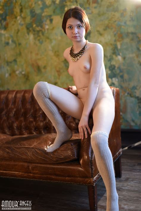 Naked Teen Lusia Poses In Knees Socks To Show Off Her