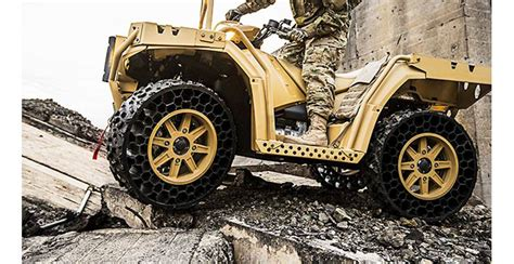 Polaris Airless Tires by Rugged Atv With Airless Tires Is Virtually Indestructible