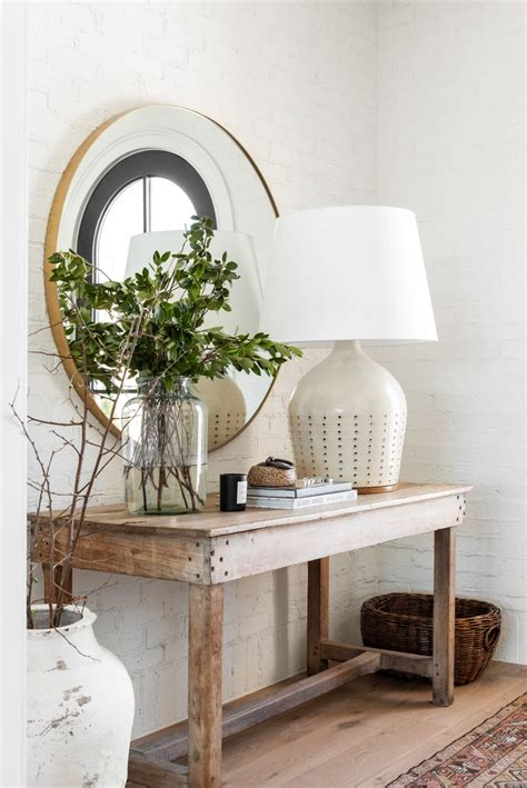 This is especially challenging if you have a round coffee table. THE MCGEE HOME ENTRYWAY PHOTO TOUR   Rattan basket, Large round mirror, Entryway
