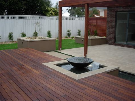 small water features for decks tall grass landscapes decking with inbuilt water feature 187 tall grass landscapes