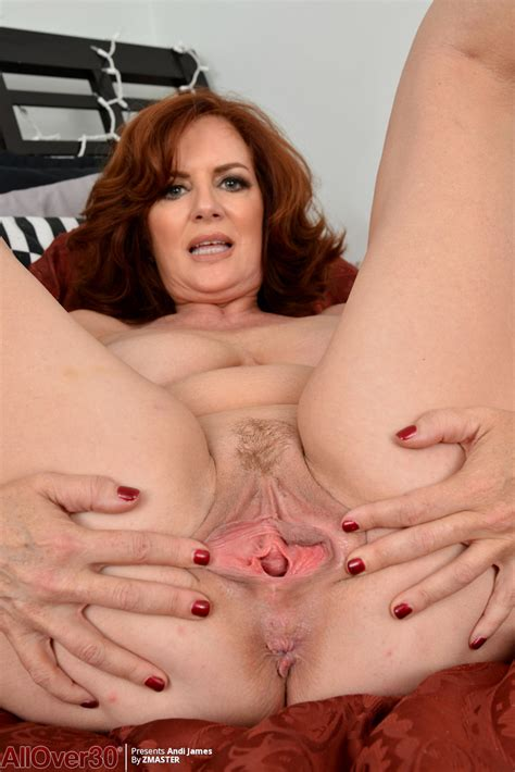 Natural Redhead Andi James Bares Saggy Tits And Spreads Vagina To Finger Fuck