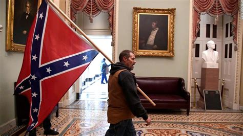 kevin seefried  carrying confederate flag