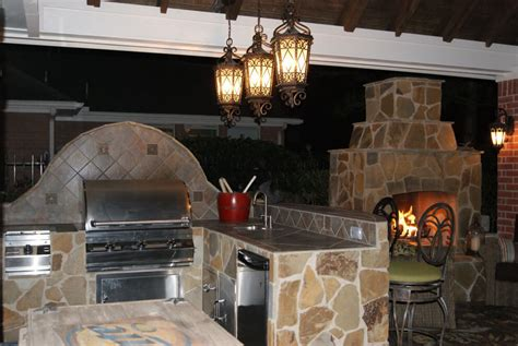 gable roof patio cover  outdoor kitchen fireplace