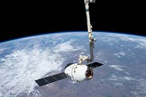 File:ISS-31 SpaceX Dragon spacecraft is grappled by ...
