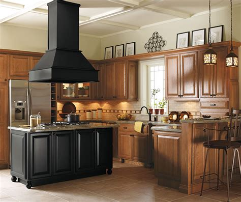 light oak cabinets with black kitchen island schrock
