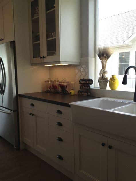 white cabinets farmhouse sink oil rubbed bronze hardware