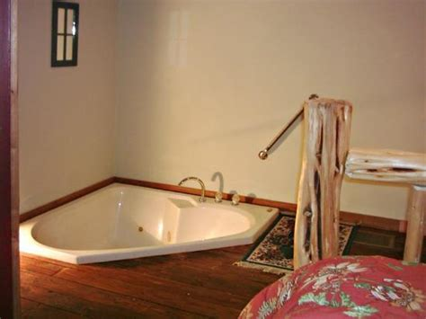 master bedroom   floor  person jacuzzi picture