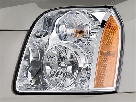 image 2011 gmc yukon 2wd 4 door 1500 slt headlight size
