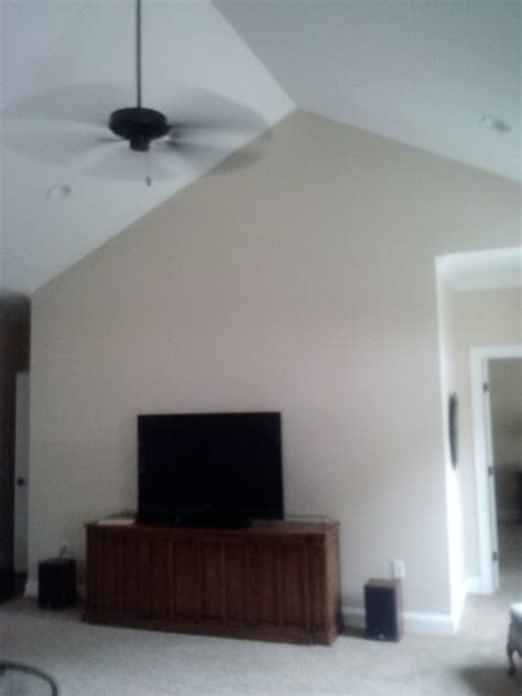 how to decorate a wall in a vaulted ceiling room