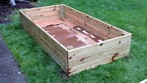 Inexpensive raised garden bed ideas frugal gardening for Inexpensive raised garden bed ideas