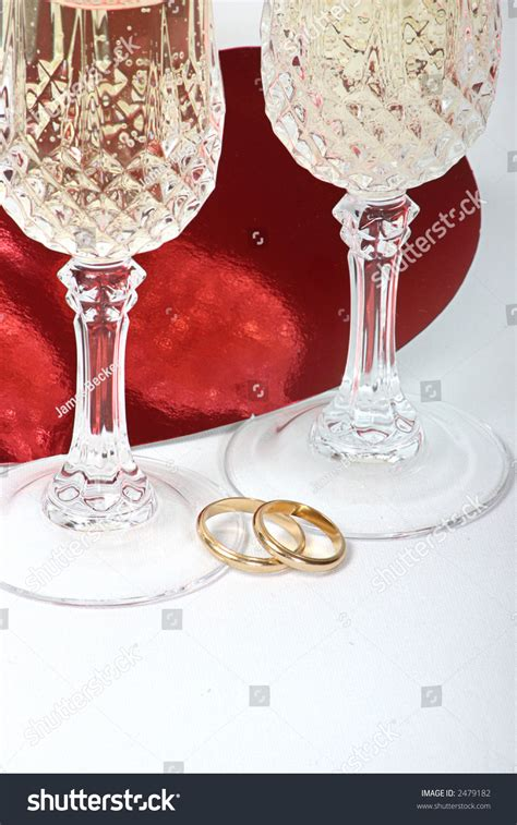 Pair Wedding Rings Champagne Glasses Toast Stock Photo