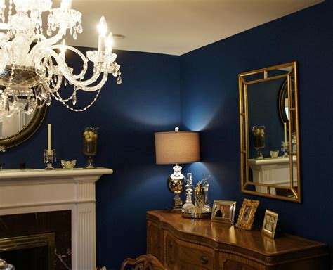 absolutely love  navy blue wall  gold accents