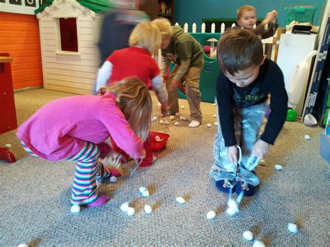 large group preschool christmas activities snowball scatter cotton balls around the room and children them up using