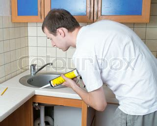 kitchen sink sealant plumber putting a silicone sealant to installing a kitchen 2871