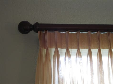 master bedroom pleated sheers on estate rods