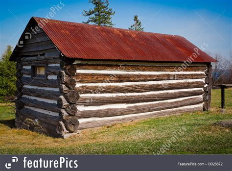 small  log cabin  rusted tin roof picture