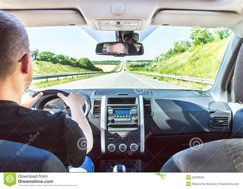 The Man Is Driving His Car With Hands On The Steering