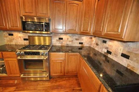 uba tuba granite with oak cabinets a small kitchen remodel project with a tile backsplash