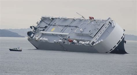 Tug Boat Owners In Singapore by Hoegh Osaka Cargo Ship Was Deliberately Grounded Off