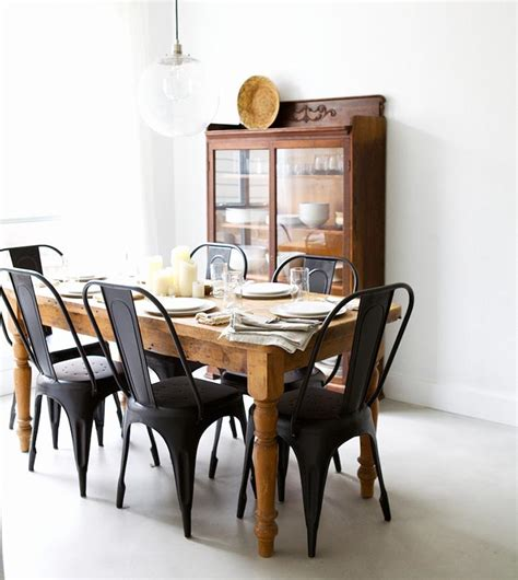 black dining room table and chairs matte black chairs with a rustic wooden table from