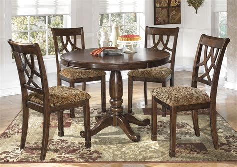 dining room table 4 chairs alabama furniture market leahlyn round dining table w 4