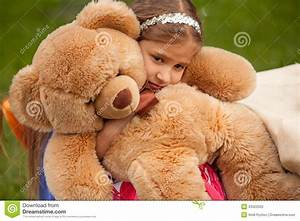 Photo Of Sad Little Girl Hugging Teddy Bear Stock Photo ...