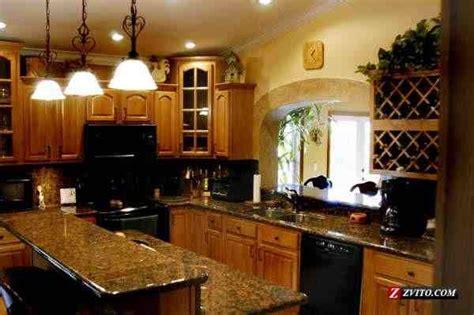 autumn cabinets with black uba tuba granite counter