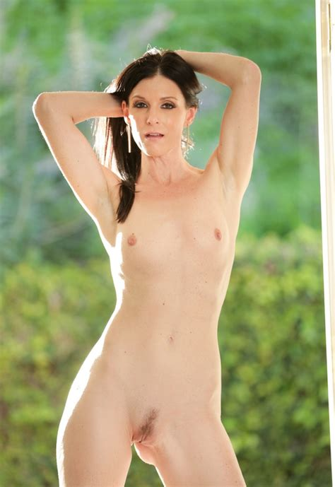 elegant woman india summer takes off dress without lingerie in the morning