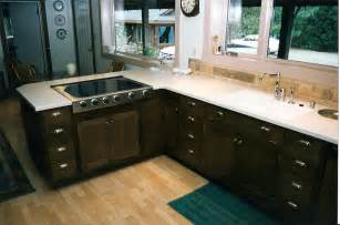 oak kitchen furniture black color staining oak kitchen cabinets with white countertop steel sinks and dishwasher plus