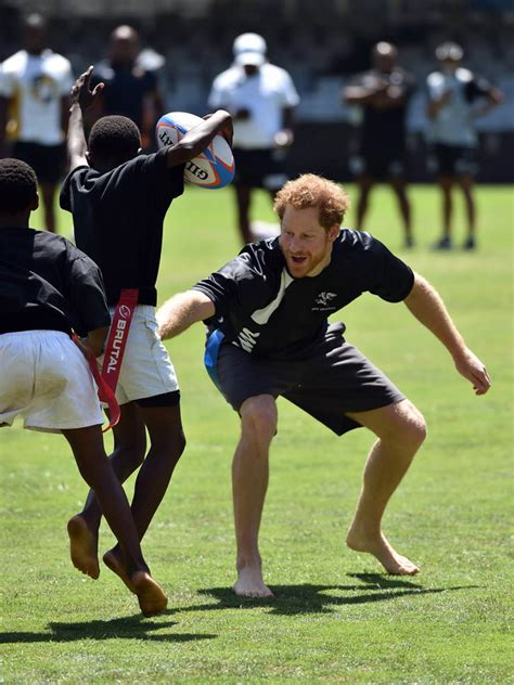 prince harry   beach  playing rugby  bare feet