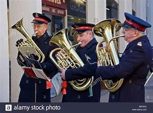 Salvation Army bandsmen, playing Christmas carols, to ...