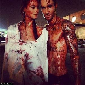 Adam Levine and Behati Prinsloo get smeared in blood on ...