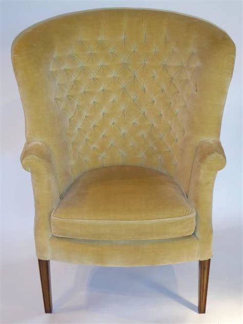 architectural high back tufted velvet wingback chair at